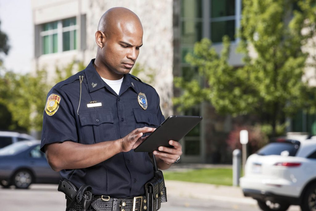 police officer on ipad