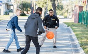 police officer playing basketball
