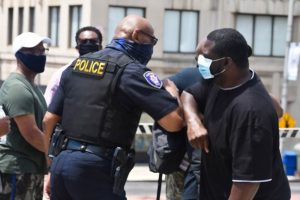 police officer hugging citizen